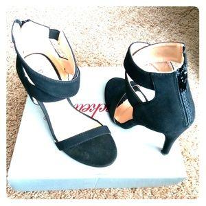 A pair of Black Suede Bonnibel Heels
